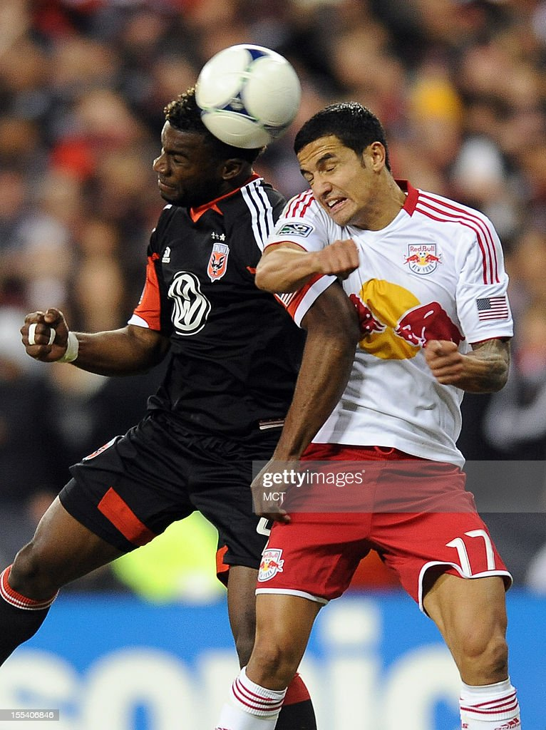 D.C. United defender Brandon McDonald (4), left, and New York Red Bulls midfielder Tim Cahill (17) battle for a head ball during second-half action in an MLS Eastern Conference semifinal at RFK Stadium in Washington, D.C., Saturday, November 3, 2012. United and the Red Bulls tied 1-10.