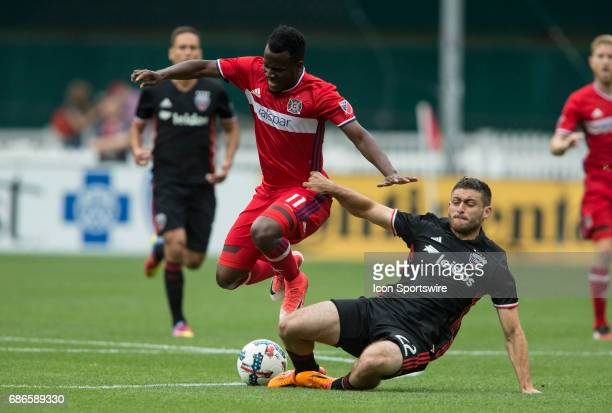 United defender Chris Korb slides into Chicago Fire forward David Accam during a MLS match between DC United and the Chicago Fire on May 20 at RFK...