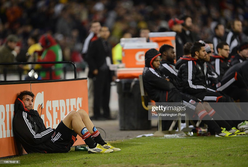 D.C. United defender Emiliano Dudar (19), left, watches the final minutes from the sidelines after being taken out of the second game of the Eastern Conference Finals between the D.C. United and the Houston Dynamo at RFK Stadium on Sunday, November 18, 2012. The D.C. United tied 1-1 with Houston Dynamo but lost the Eastern Conference Final with an aggregate score of 4-2.