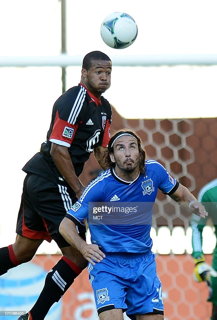 D.C. United defender Ethan White (15), left, goes for a head ball over San Jose Earthquakes forward <a gi-track='captionPersonalityLinkClicked' href=/galleries/search?phrase=Alan+Gordon+-+Soccer+Player&family=editorial&specificpeople=11667134 ng-click='$event.stopPropagation()'>Alan Gordon</a> (24) in the first half at RFK Stadium in Washington, D.C., Saturday, June 22, 2013.