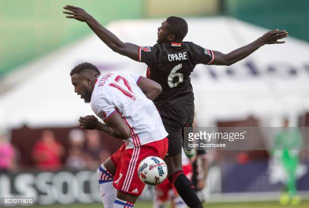 C United defender Kofi Opare and Toronto FC forward Jozy Altidore clash in midair during a MLS match between DC United and Toronto FC on August 05 at...
