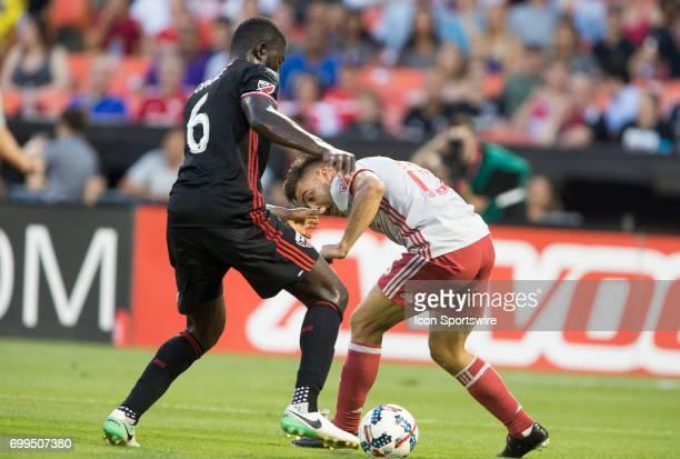 C United defender Kofi Opare defends against Atlanta United forward Hector Villalba during a MLS match between DC United and Atlanta United FC on...