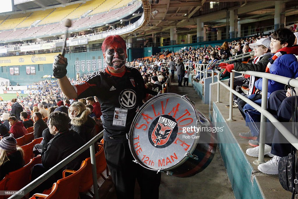 A D.C. United fan bangs on a drum in the stands during the second half of the D.C. United and Real Salt Lake game at RFK Stadium on March 9, 2013 in Washington, DC.