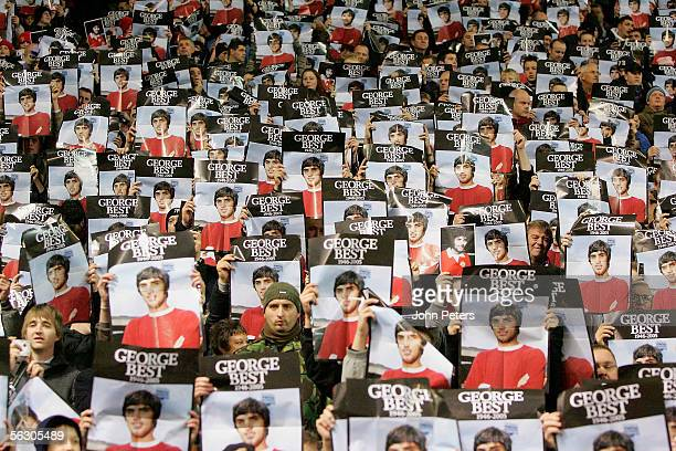 United fans hold up posters honouring George Best during a tribute to the former player ahead of the Carling Cup match between Manchester United and...