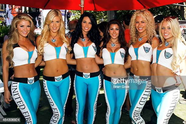 United Fiber Data spokesmodels pose at the Verizon IndyCar Series at The Grove on August 28 2014 in Los Angeles California