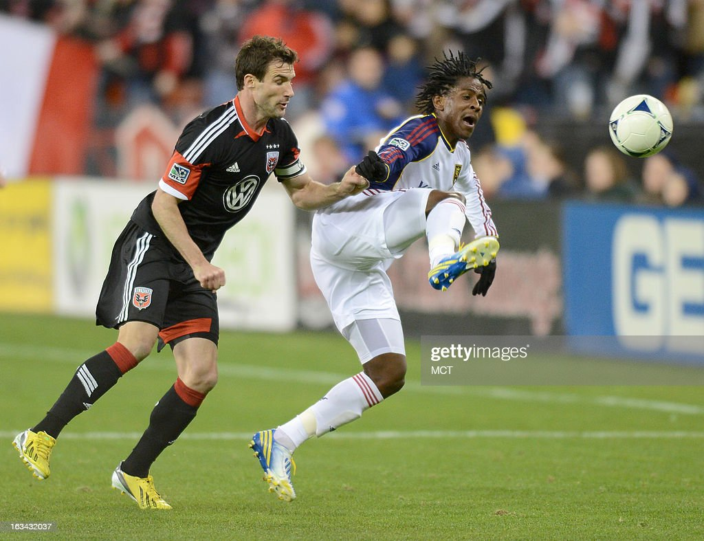 D.C. United forward Chris Pontius (13), left, shoves Real Salt Lake midfielder Lovel Palmer (7) as he attempts to make a play on the ball in the second half at RFK Stadium in Washington, D.C., Saturday, March 9, 2013. United defeated RSL, 1-0.