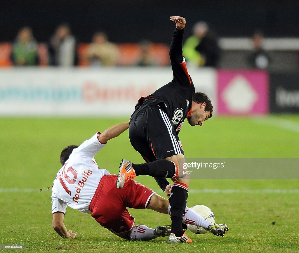 D.C. United forward Chris Pontius (13) step over a tackle attempt by New York Red Bulls defender Connor Lade (16) during first-half action in an MLS Eastern Conference semifinal at RFK Stadium in Washington, D.C., Saturday, November 3, 2012.