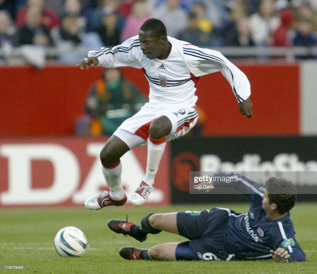 DC United forward Freddy Adu jumps over New England Revolution defender Jay Heaps during the first half of the game at Gillette Stadium in Foxboro...