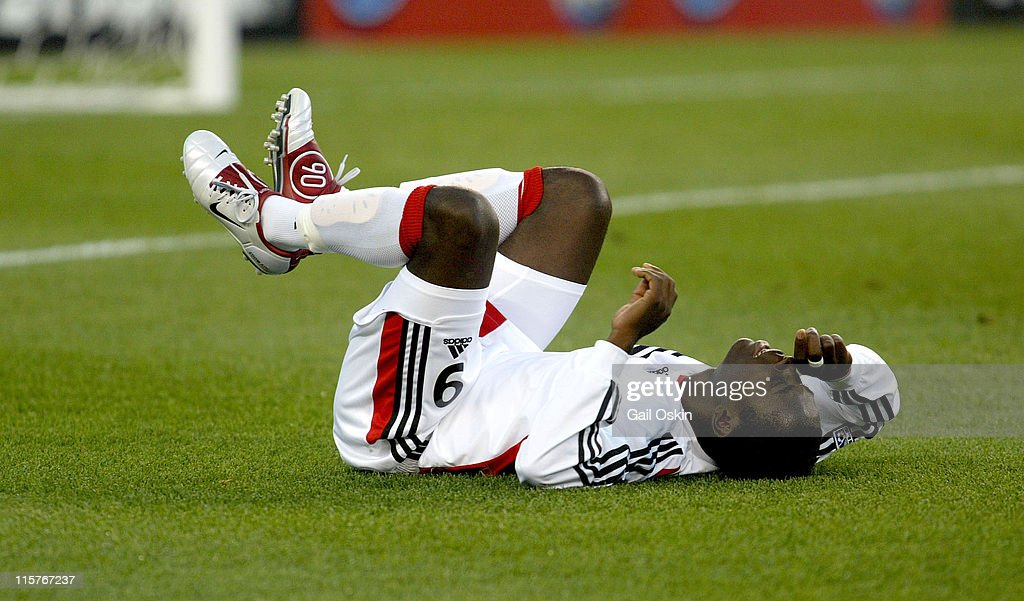 DC United forward Freddy Adu lies on his back after falling in the second half of the game aginst the New England Revolution at Gillette Stadium in...