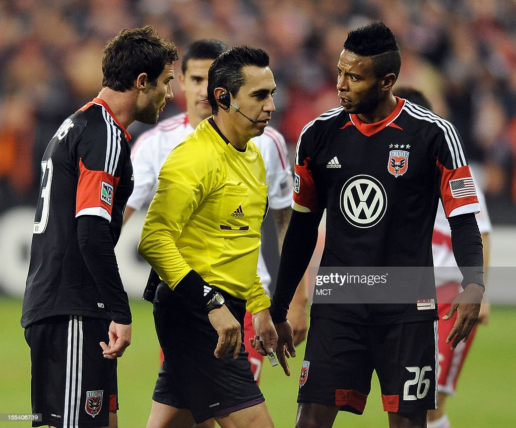 D.C. United forward Lionard Pajoy (26) and D.C. United midfielder-captain Chris Pontius (13) complain to referee Jair Marruto, after Pajoy went down hard to the ground with New York Red Bulls defender Heath Pierce, during second-half action in an MLS Eastern Conference semifinal at RFK Stadium in Washington, D.C., Saturday, November 3, 2012. United and the Red Bulls tied 1-10.