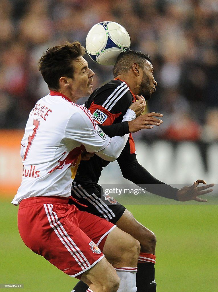 D.C. United forward Lionard Pajoy, right, and New York Red Bulls defender Heath Pierce (3) battle for the ball during second-half action in an MLS Eastern Conference semifinal at RFK Stadium in Washington, D.C., Saturday, November 3, 2012. United and the Red Bulls tied 1-10.