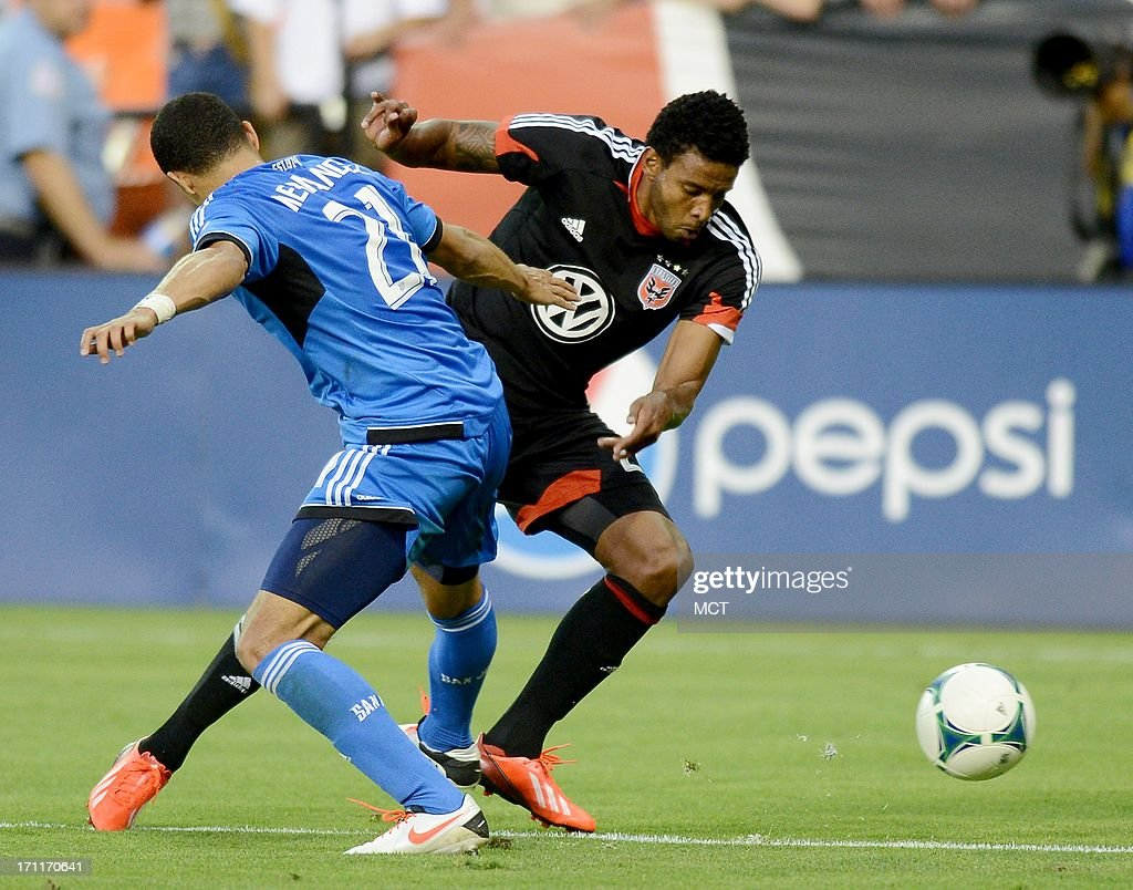 D.C. United forward Lionard Pajoy (26), right, makes a move past San Jose Earthquakes defender Jason Hernandez (21) in the second half at RFK Stadium in Washington, D.C., Saturday, June 22, 2013. United defeated the Quakes, 1-0.