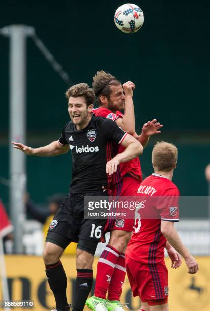 C United forward Patrick Mullins and Chicago Fire defender Joao Meira go up for a header during a MLS match between DC United and the Chicago Fire on...