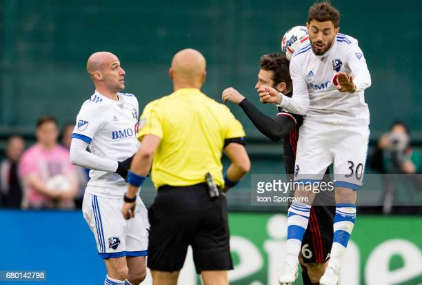 C United forward Patrick Mullins and Montreal Impact midfielder Hernan Bernardello clash in the air during a MLS game between DC United and the...