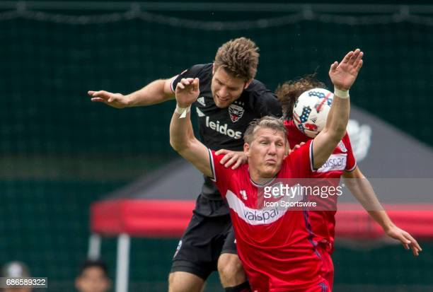 C United forward Patrick Mullins crashes into the back of Chicago Fire midfielder Bastian Schweinsteiger during a MLS match between DC United and the...