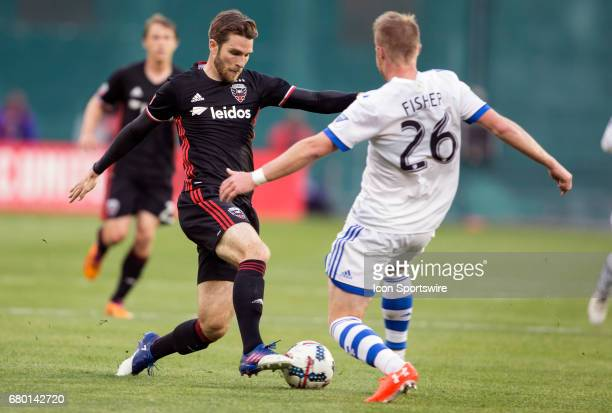 C United forward Patrick Mullins dribbles past Montreal Impact defender Kyle Fisher during a MLS game between DC United and the Montreal Impact on...