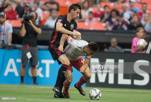 C United forward Sebastien Le Toux holds onto Atlanta United forward Hector Villalba during a MLS match between DC United and Atlanta United FC on...