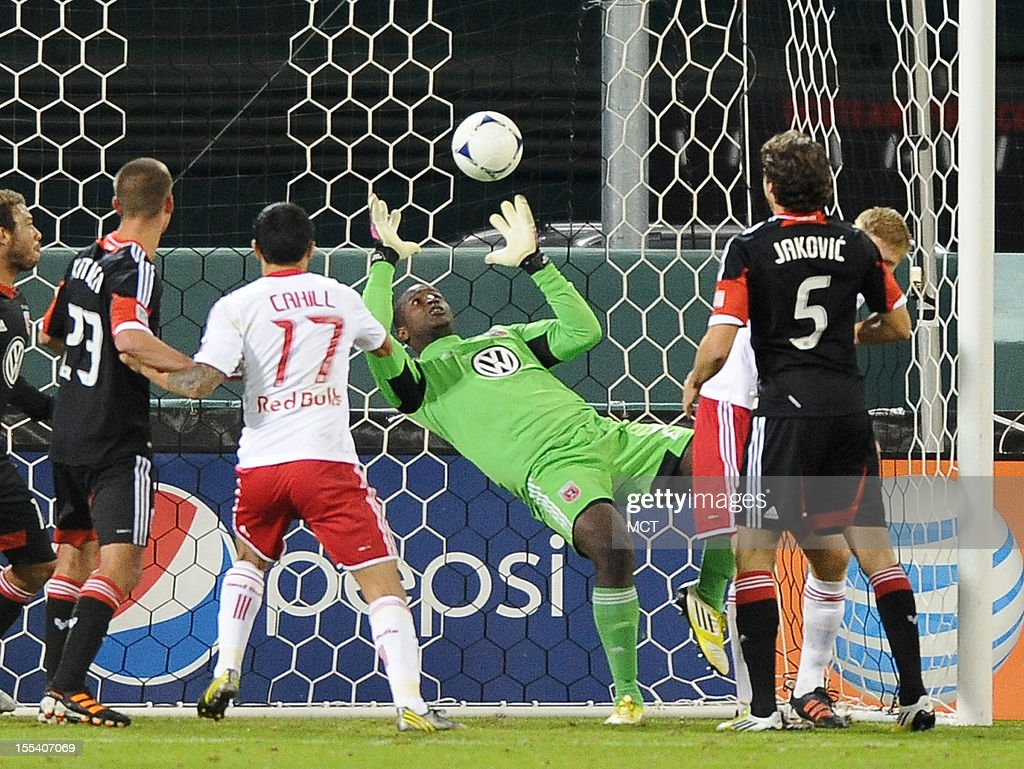 D.C. United goalkeeper Bill Hamid (28) falls inside his goal as he attempts to make a save against the New York Red Bulls during second-half action in an MLS Eastern Conference semifinal at RFK Stadium in Washington, D.C., Saturday, November 3, 2012. The Red Bulls' Roy Miller was credited with United's own goal. United and the Red Bulls tied 1-10.