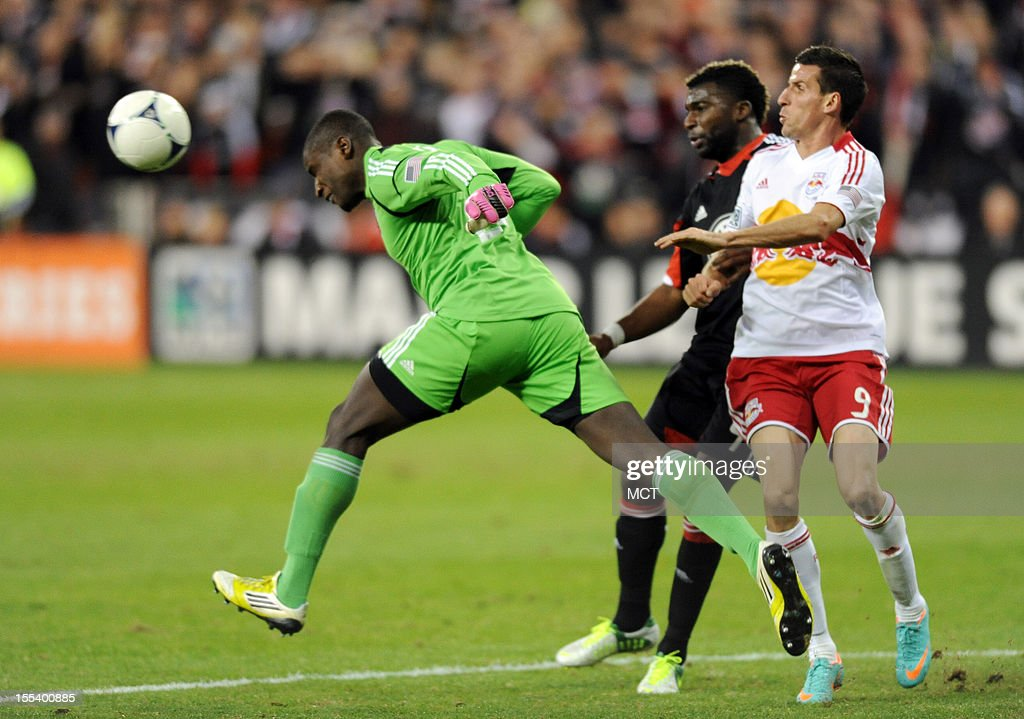 D.C. United goalkeeper Bill Hamid (28) heads the ball away from his goal as D.C. United defender Brandon McDonald (4) plays New York Red Bulls forward Sebastien Le Toux (9) during first-half action in an MLS Eastern Conference semifinal at RFK Stadium in Washington, D.C., Saturday, November 3, 2012.