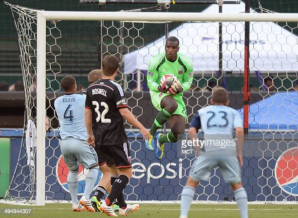 DC United goalkeeper Bill Hamid makes a save against Sporting KC in the first half at RFK Stadium in Washington Saturday May 31 2014 United defeated...