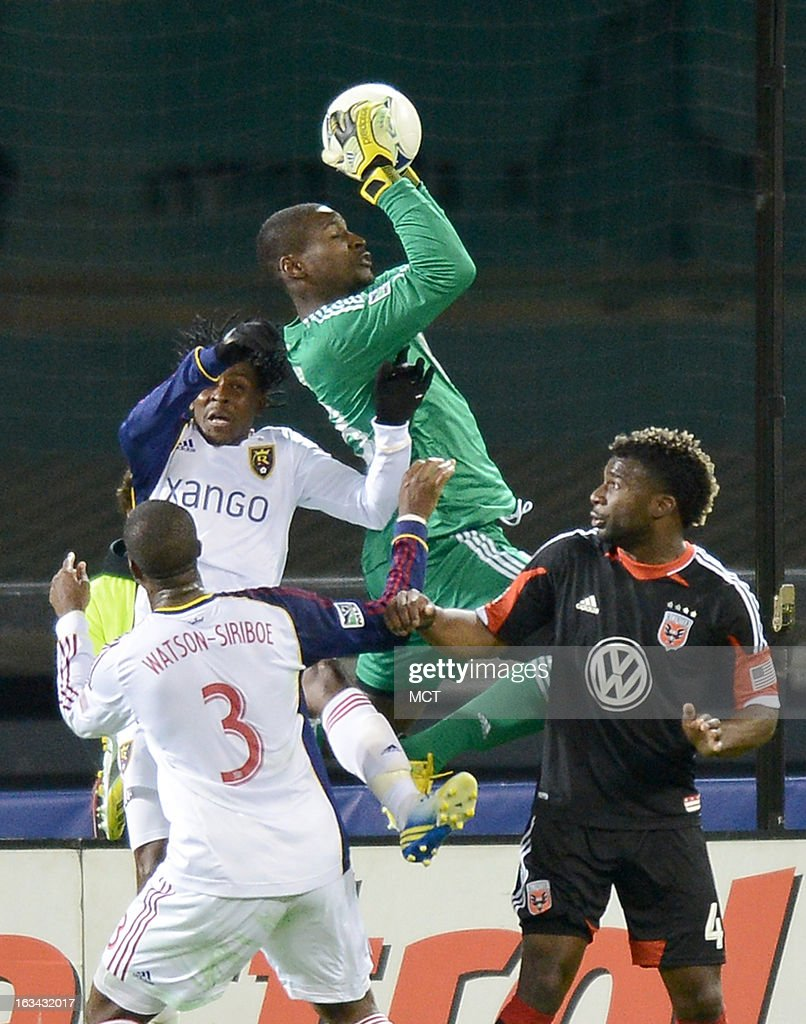 D.C. United goalkeeper Bill Hamid (28) pulls down the ball against Real Salt Lake midfielder Lovel Palmer (7) during a Real Salt Lake corner kick in the second half at RFK Stadium in Washington, D.C., Saturday, March 9, 2013. United defeated RSL, 1-0.