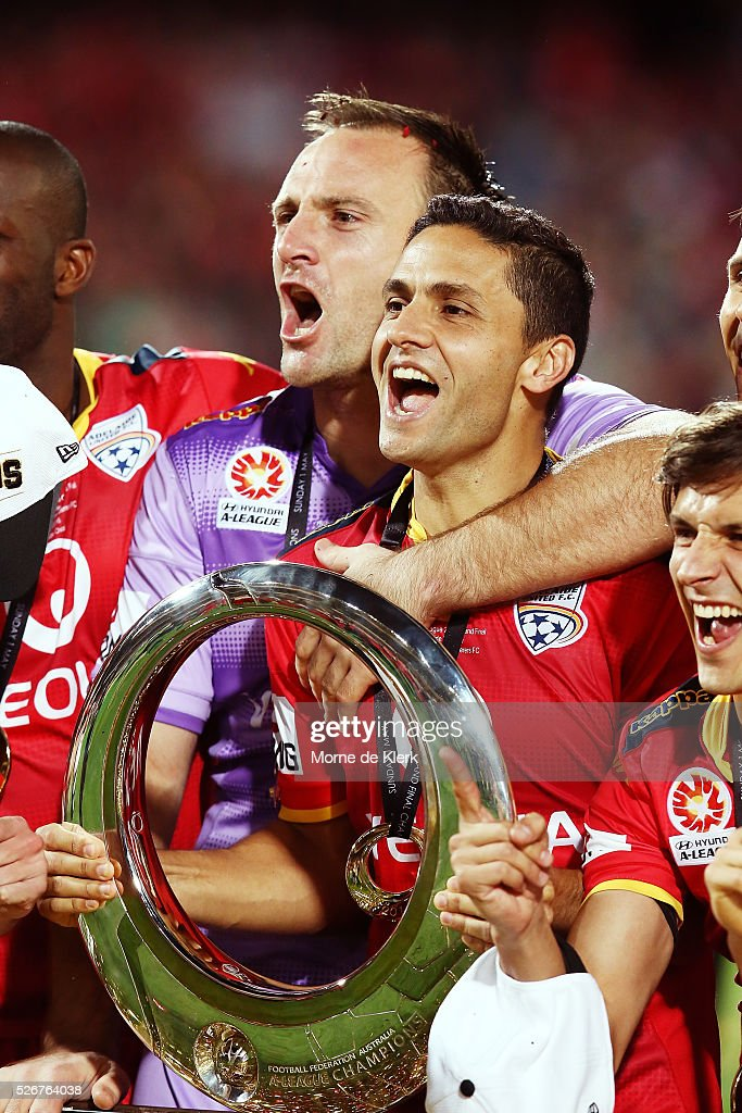 United goalkeeper Eugene Galekovic and Marcelo Carrusca celebrate with the trophy after the 2015/16 A-League Grand Final match between Adelaide United and the Western Sydney Wanderers at the Adelaide Oval on May 1, 2016 in Adelaide, Australia.
