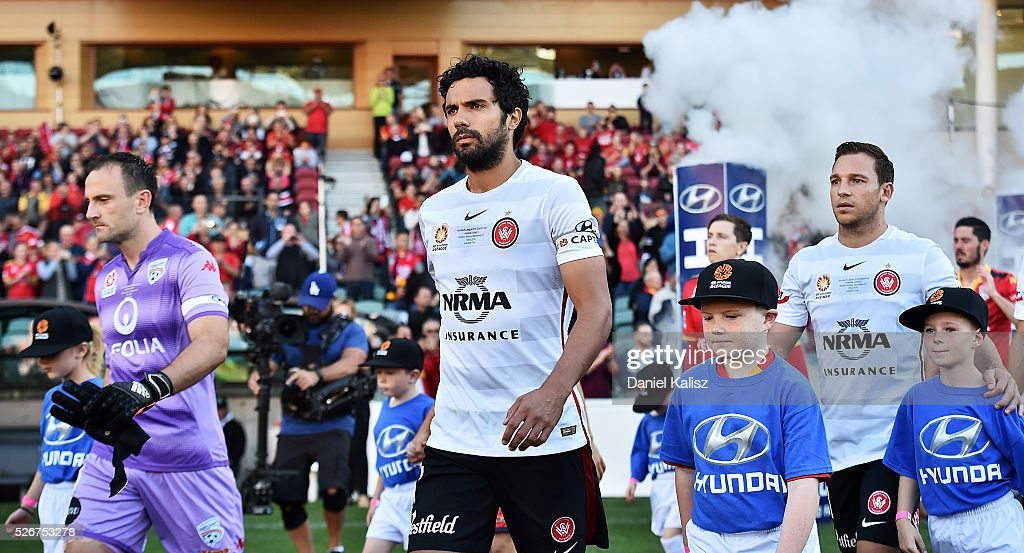 United goalkeeper Eugene Galekovic and Nikolai Topor-Stanley of the Wanderes leads their players out onto the field prior to the 2015/16 A-League Grand Final match between Adelaide United and the Western Sydney Wanderers at Adelaide Oval on May 1, 2016 in Adelaide, Australia.