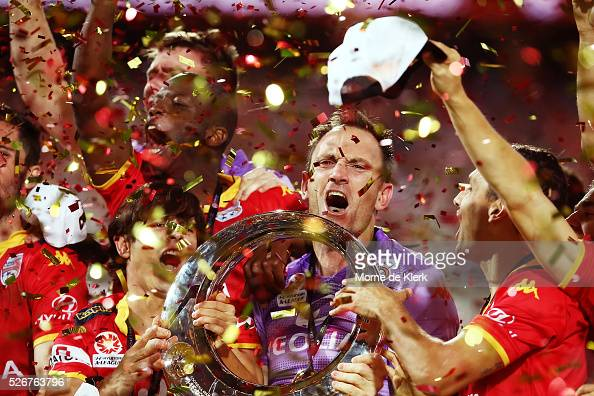 United goalkeeper Eugene Galekovic celebrates with the trophy after the 2015/16 ALeague Grand Final match between Adelaide United and the Western...