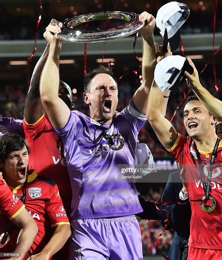 United goalkeeper Eugene Galekovic lifts the trophy after during the 2015/16 A-League Grand Final match between Adelaide United and the Western Sydney Wanderers at Adelaide Oval on May 1, 2016 in Adelaide, Australia.