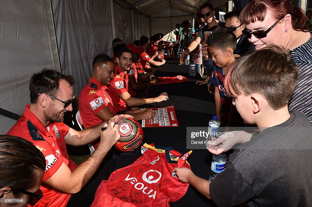 United goalkeeper Eugene Galekovic signs an autograph for a fan during the A-League Grand Final Fan Day at Bonython Park on April 30, 2016 in Adelaide, Australia.