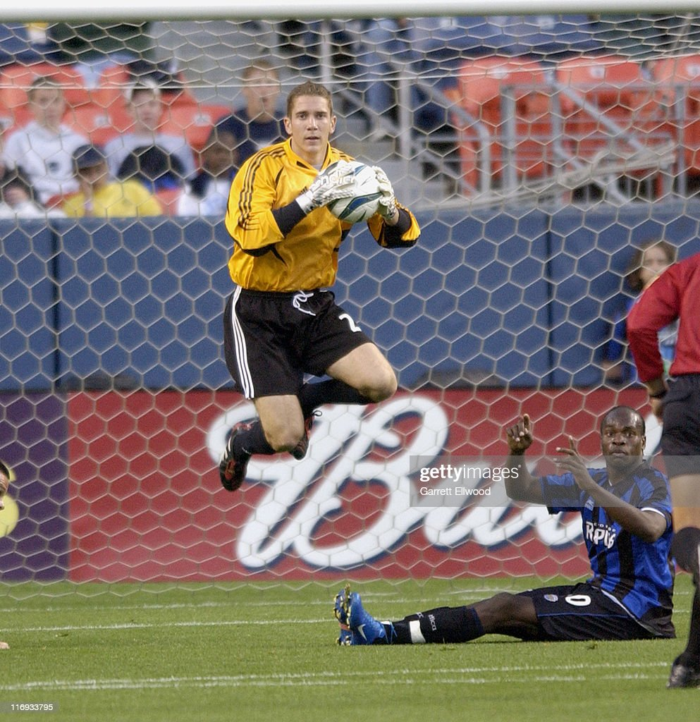 DC United Goalkeeper Troy Perkins goes up for a save during DC United versus the Colorado Rapids on May 22 2004 Invesco Field at Mile High in Denver...