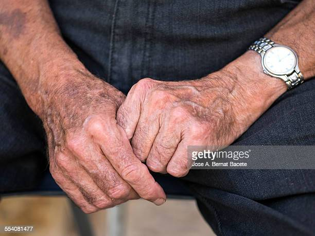 United hands of an elder