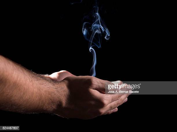 United hands of which a column of smoke flows