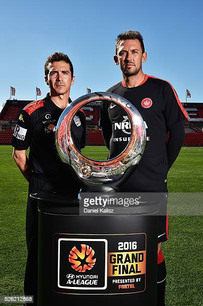 United head coach Guillermo Amor and Wanderers head coach Tony Popovic pose for a photo with the Hyundai Championship ALeague trophy during the media...