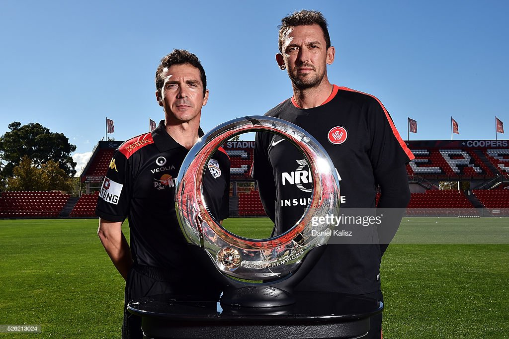 United head coach Guillermo Amor and Wanderers head coach <a gi-track='captionPersonalityLinkClicked' href=/galleries/search?phrase=Tony+Popovic&family=editorial&specificpeople=213704 ng-click='$event.stopPropagation()'>Tony Popovic</a> pose for a photo with the Hyundai Championship A-League trophy during the media during the A-League Grand Final press conference at Coopers Stadium on April 30, 2016 in Adelaide, Australia.