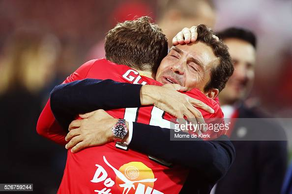 United head coach Guillermo Amor celebrates with Craig Goodwin of Adelaide United after winning the 2015/16 ALeague Grand Final match between...