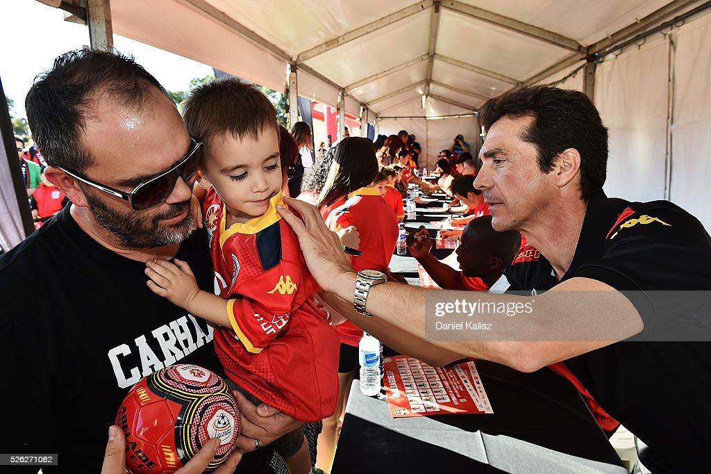 United head coach Guillermo Amor signs an autograph for a fan during the A-League Grand Final Fan Day at Bonython Park on April 30, 2016 in Adelaide, Australia.