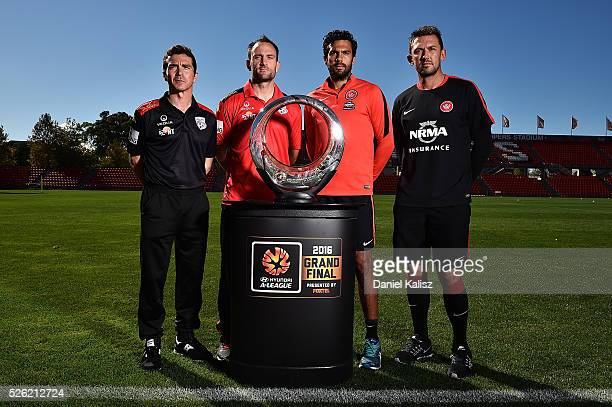 United head coach Guillermo Amor United captain Eugene Galekovic Wanderers captain Nikolai ToporStanley and Wanderers head coach Tony Popovic pose...