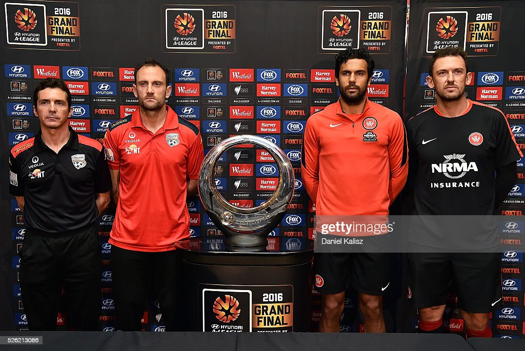 United head coach Guillermo Amor, United captain Eugene Galekovic, Wanderers captain Nikolai Topor-Stanley and Wanderers head coach Tony Popovic pose for a photo with the Hyundai Championship A-League trophy during the media during the A-League Grand Final press conference at Coopers Stadium on April 30, 2016 in Adelaide, Australia.