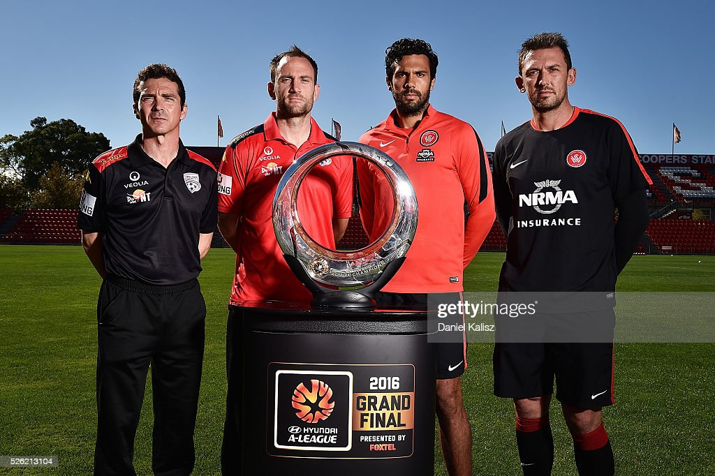 United head coach Guillermo Amor, United captain Eugene Galekovic, Wanderers captain <a gi-track='captionPersonalityLinkClicked' href=/galleries/search?phrase=Nikolai+Topor-Stanley&family=editorial&specificpeople=2517636 ng-click='$event.stopPropagation()'>Nikolai Topor-Stanley</a> and Wanderers head coach <a gi-track='captionPersonalityLinkClicked' href=/galleries/search?phrase=Tony+Popovic&family=editorial&specificpeople=213704 ng-click='$event.stopPropagation()'>Tony Popovic</a> pose for a photo with the Hyundai Championship A-League trophy during the media during the A-League Grand Final press conference at Coopers Stadium on April 30, 2016 in Adelaide, Australia.