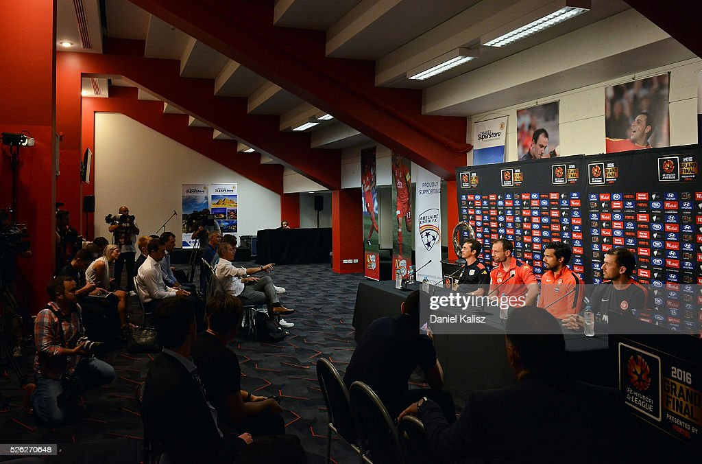 United head coach Guillermo Amor, United captain Eugene Galekovic, Wanderers captain <a gi-track='captionPersonalityLinkClicked' href=/galleries/search?phrase=Nikolai+Topor-Stanley&family=editorial&specificpeople=2517636 ng-click='$event.stopPropagation()'>Nikolai Topor-Stanley</a> and Wanderers head coach <a gi-track='captionPersonalityLinkClicked' href=/galleries/search?phrase=Tony+Popovic&family=editorial&specificpeople=213704 ng-click='$event.stopPropagation()'>Tony Popovic</a> look on during the media during the A-League Grand Final press conference at Coopers Stadium on April 30, 2016 in Adelaide, Australia.