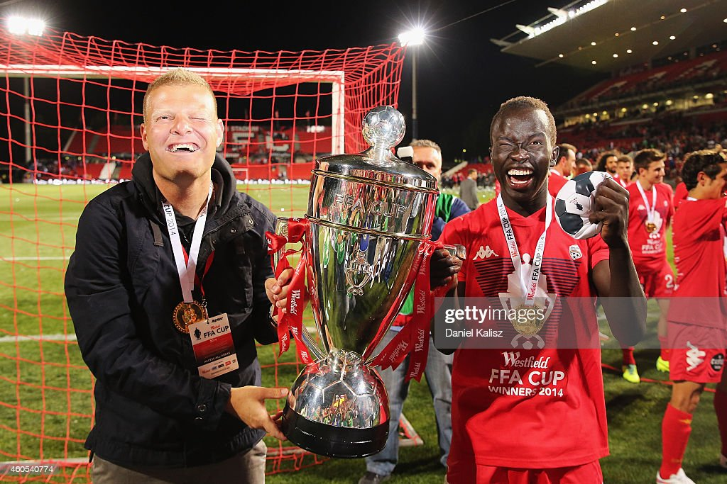 United head coach Josep Gombau (L) celebrates with Awer Mabil of United after the FFA Cup Final match between Adelaide United and Perth Glory at Coopers Stadium on December 16, 2014 in Adelaide, Australia.