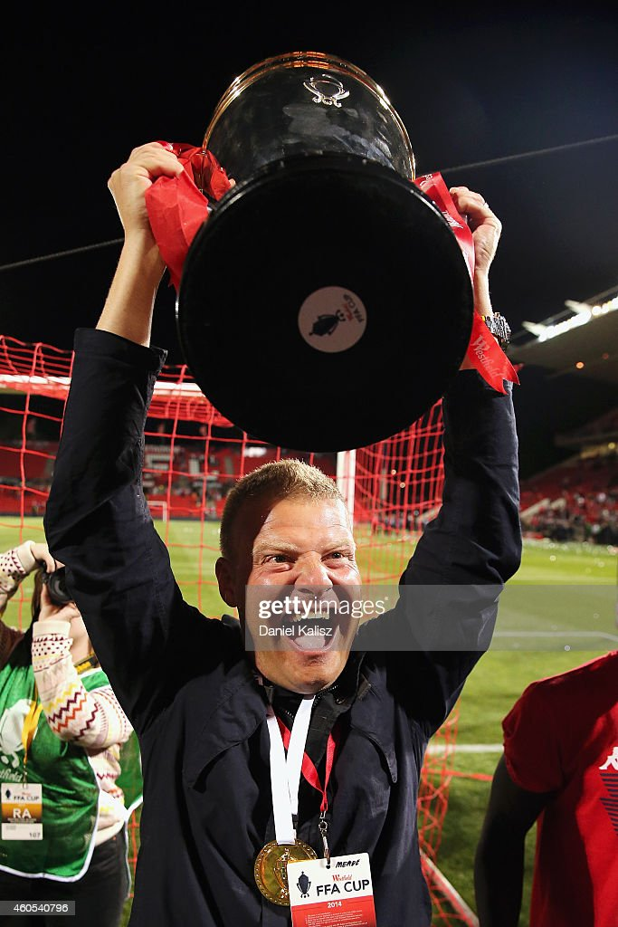 United head coach Josep Gombau reacts to the crowd with the FFA Cup during the FFA Cup Final match between Adelaide United and Perth Glory at Coopers Stadium on December 16, 2014 in Adelaide, Australia.