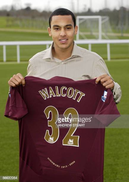 16 yearold Theo Walcott poses with an Arsenal football club shirt at the club's training ground near London Colney in Hertfordshire 20 January 2006...