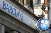 A Barclays Bank branch signboard is pictured in North London 21 February 2006 Barclays Bank unveiled Tuesday record year profits of GBP528bn with its...