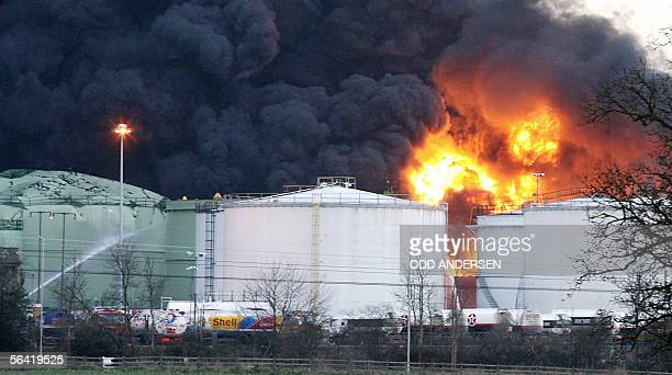 A fierce fire continues to burn at the center of an explosion at Buncefield oil depot in Hemel Hempstead on the outskirts of London 12 December 2005...