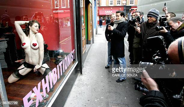 A model displays lingerie in a shop window at Agent Provacateur in London 23 November 2005 as the lingerie retail company launches a book enitled...