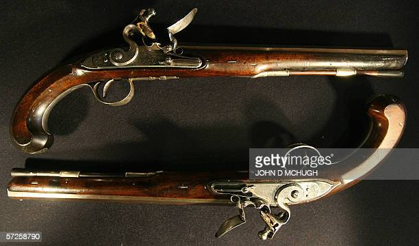 A rare pair of Irish 22bore silvermounted flintlock duelling pistols are pictured at Bonham's auctin house in London 05 April 2006 The pistols are...