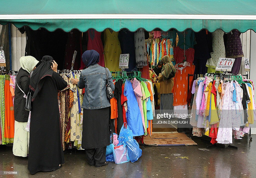 A variety of headscarves and veils are worn by women at the Whitechapel market in east London 06 October 2006 British former Foreign Secretary Jack...