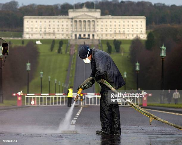 A worker cleans the entrance to Stormont Parliament building 30 November 2005 in Belfast Northern Ireland in preparation for the funeral of the late...